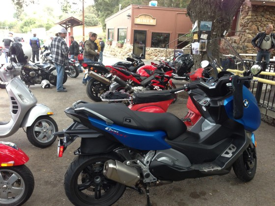 The C650 Sport eclipses a Vespa P200 and is larger than many other motorcycles at the Rock Store, a popular biker stop.